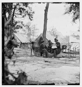 General Burnside reading a newspaper with Matthew Brady, 1864