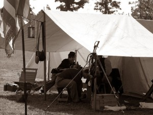 Reenactors enjoy some food, drink and shade