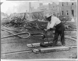 Railroad worker straightening out destroyed track in 1862-1863.  (Library of Congress)