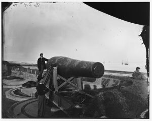 """The """"Lincoln Gun"""" at Fort Monroe, 1864.  Named in honor of the president, it was used in 1862 and retired later in the year, replaced by more accurate rifled cannons.  (Library of Congress)"""