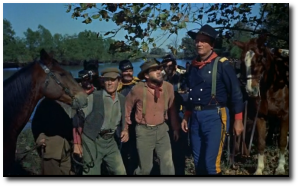 "Colonel John Wayne, USA, and his troops, who are both in and out of uniform, during a raid into enemy territory in ""The Horse Soldiers"" (1959)."