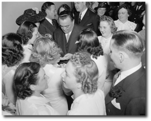 It's hard to see his nose in this picture of J. Edgar Hoover in a crowd of admirers, four years before The Doorbell Rang came out.  (Library of Congress)
