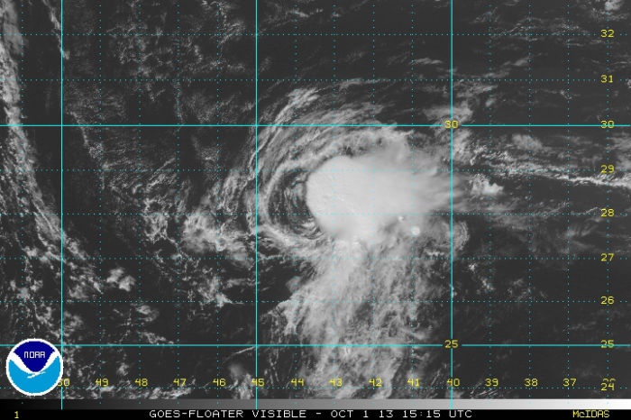 The cost of wind shear:  Jerry's low-level center is exposed just to the west of that blob of disorganized convection.  This is not a healthy-looking tropical cyclone.  (GOES)
