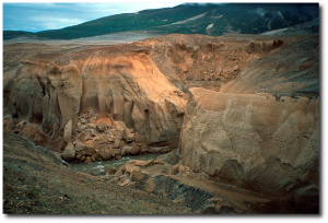 Today, water erodes part of the thick ash bed covering the Valley of Ten Thousand Smokes.  Source.