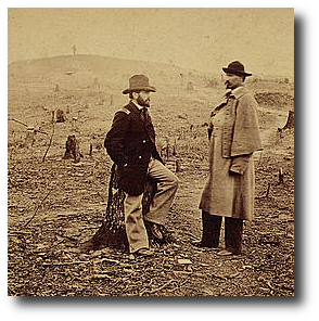 U. S. Engineers O.E. Babcock, left, seated on a tree stump, and O. M. Poe, right, standing on a war damaged salient in Fort Sanders in 1863.  Poe oversaw construction of Knoxville's defenses.  (Library of Congress)
