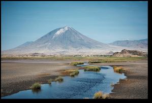 Oldoinyo Lengai, seen from Lake Natron.  (Image:  Clem23)