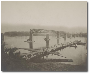 Destroyed bridge across the Tennessee River (location uncertain) and pontoon bridge under construction in 1863.  (Library of Congress)