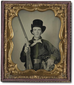 Unidentified 1st Mississippi cavalryman in uniform and Confederate wishbone frame buckle, with 1st model Maynard carbine.  (Library of Congress)