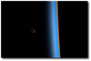 Rise of a crescent moon, from the space station.  (Source)