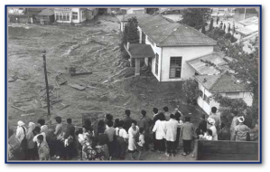 "In this cover photo of the United States Geological Survey's, ""Surviving Tsunamis, residents of Onagawa, Japan, watch an incoming tsunami that was generated from the magnitude 9.5 Valdivia, Chile, earthquake in 1960."