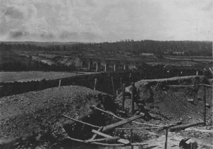 The railroad bridge over the Chattahoochee, with abandoned Confederate works in the foreground.  (National Park Service)