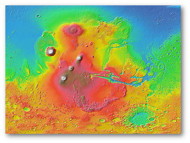 The Tharsis region (shown in shades of red and brown) dominates the western hemisphere of Mars as seen in this Mars Orbiter Laser Altimeter (MOLA) colorized relief map. Tall volcanoes appear white. The Tharsis Montes are the three aligned volcanoes left of center. Olympus Mons sits off to the northwest. The oval feature in the north is Alba Mons.  (Wikipedia)