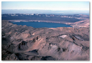 Lake Oskjuvatn sits in the crater of hte 1875 VEI 5 eruption.  Note the outer caldera in the background.  Source