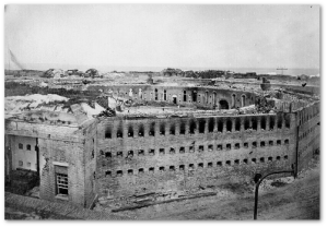 Damage to Fort Morgan, August 1864.  Note the ghostly American flag on left.  (Source)