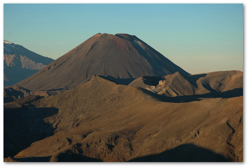 Mount Ngauruhoe rises behind Red Crater in the Tongariro volcanic complex.  (GeoNet)