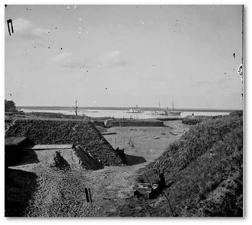 Part of Fort McAllister after the battle.  Note the US gunboats in the background.  (Library of Congress)