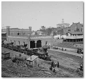 A train yard in Nashville around the time of Hood's encampment.  State capitol is in the background.  (Library of Congress)