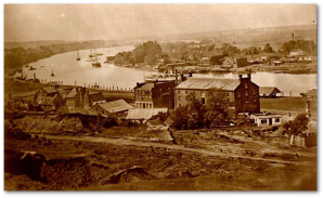 Some ships of the James River Squadron were built at the Confederate naval shipyards on the far side of the James River, in this photograph. (Source)