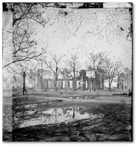 The Library of Congress citation only says these are ruins of houses in Savannah in 1865.  Presumably they're some of the 100 houses lost in the great fire.