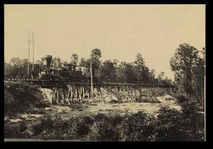 A train in the 1860s on the Neuse River Bridge, Wilmington & Goldsboro Railroad.  (Library of Congress)