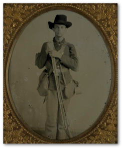 "Whoever this man is, he would be disappointed to know how he is remembered by the Library of Congress:  ""Unidentified soldier in uniform with musket, canteen, cup, and haversack; either Confederate or Union."""