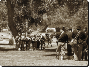 Confederate and Union troops in a 2008 reenactment.  (Rennett Stowe)