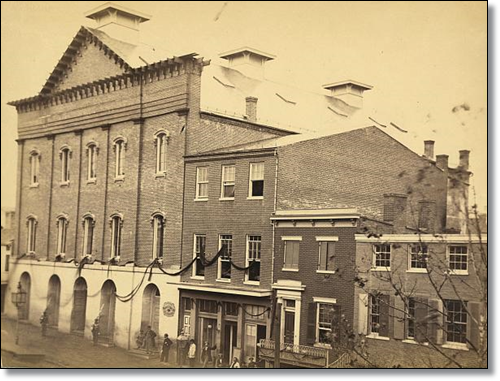 Ford's Theatre in 1865, after the assassination (note the black bunting).  No one had any reason to photograph the back alley, I suppose.  (Library of Congress)